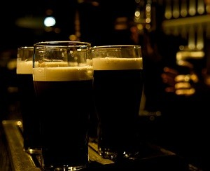Pints of Guinness stout beer served at a bar.